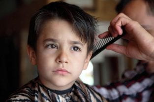 World's Sweetest Barber Helps A Boy With Autism